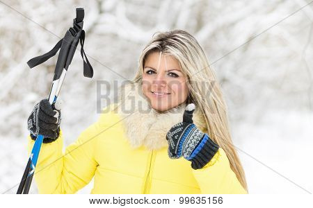 Young Happy Caucasian Woman With Ski Poles At Winter Outdoor