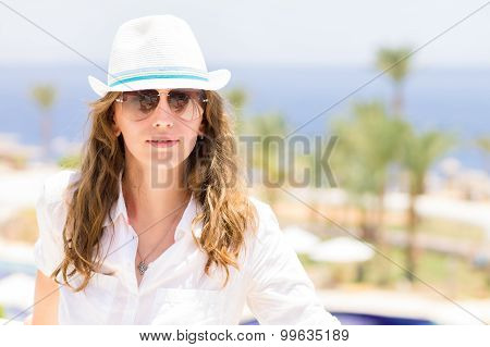 Young Lady Having Vacation At The Tropical Resort Hotel