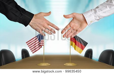 United States and Germany diplomats agreeing on a deal