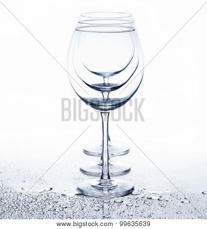 Row ofl glasses for wine on white background