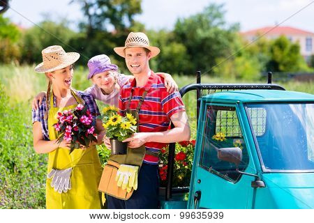 Family in garden with flowers