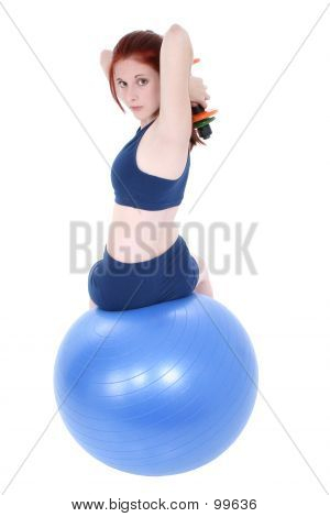 Beautiful Teenage Girl With Hand Weights And Exercise Ball