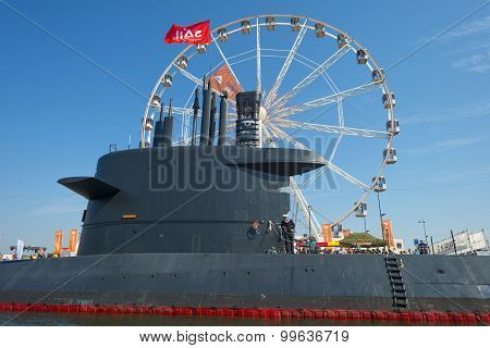 Submarine and ferris wheel in the harbor of Amsterdam