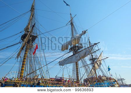 Masts of a tall ship in the harbor of Amsterdam