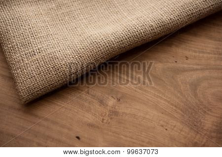 Hemp cloth on rustic wooden table. Shallow depth of field.