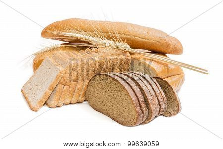 Various Bakery Products And Wheat Spikelets On A Light Background