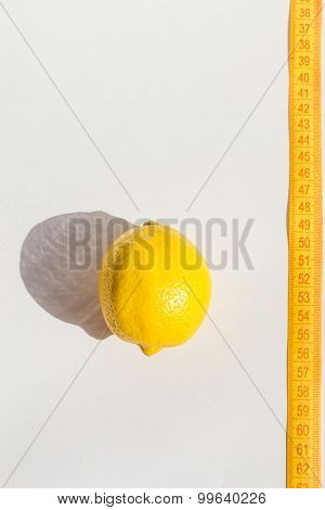 Lemon and measure tape, concept lose weight, copy space