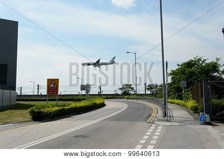 HONG KONG - JUNE 04, 2015: aircraft landing in Hong Kong International Airport. Hong Kong International Airport is the main airport in Hong Kong. It is located on the island of Chek Lap Kok