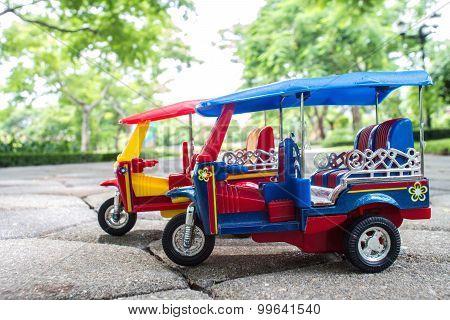Tuk Tuk Toy Car Symbol Thailand With Blurred Bokeh Background