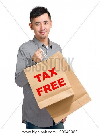 Asian man hold with shopping bag and showing tax free