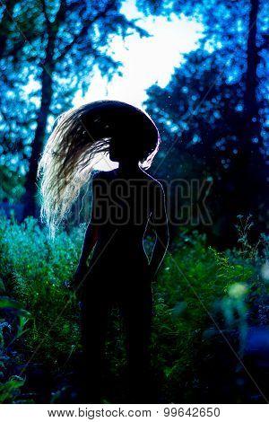 Silhouette Of Girl In Moonlight