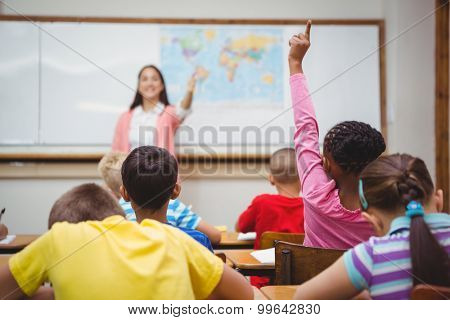 Student raising hand to ask a question at the elementary school
