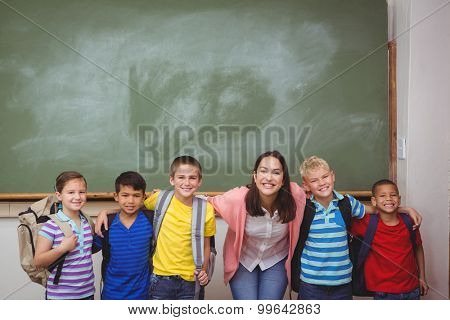 Students standing in front of blackboard at the elementary school