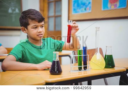 Student using lab glassware at the elementary school