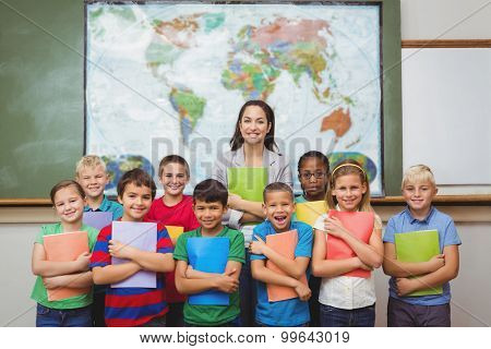 Students standing with the teacher at the elementary school