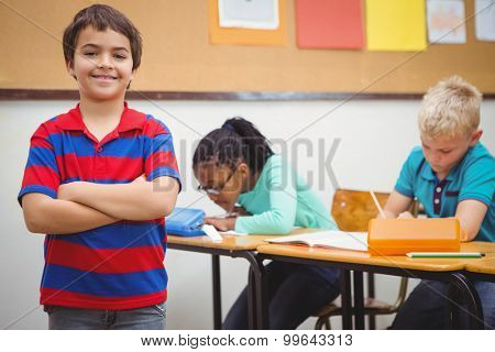 Smiling student looking at camera at the elementary school