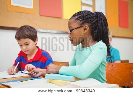 Student helping fellow student in class at the elementary school