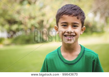 Smiling student looking at camera on the school grounds