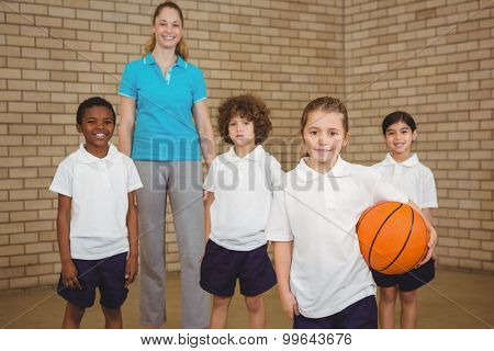 Students together about to play basketball at the elementary school