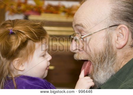 Granddaughter Checking Grandfathers Tongue!