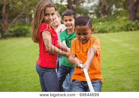 Kids pulling a large rope together