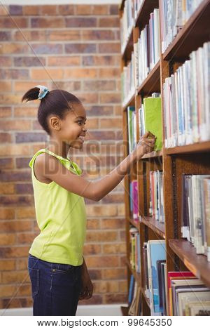 Student choosing a book at a library at the elementary school