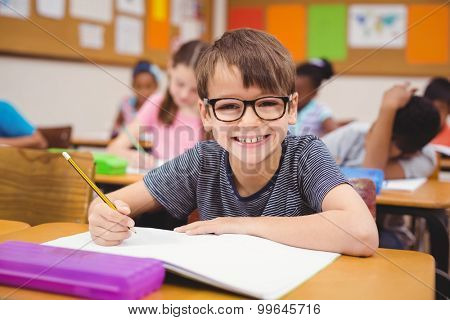Little boy working at his desk in class at the elementary school
