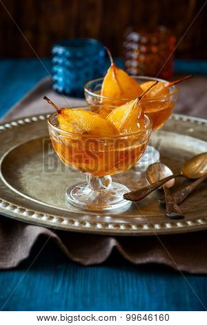 Poached pears in spiced syrup for holiday. soft focus