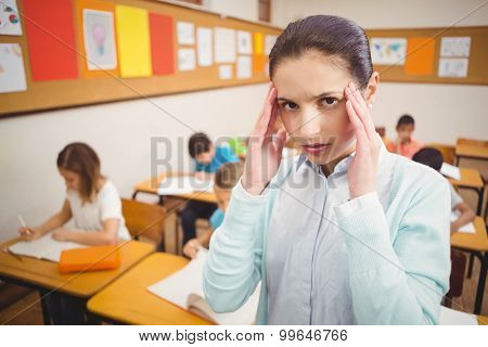 Teacher getting a headache in class at the elementary school