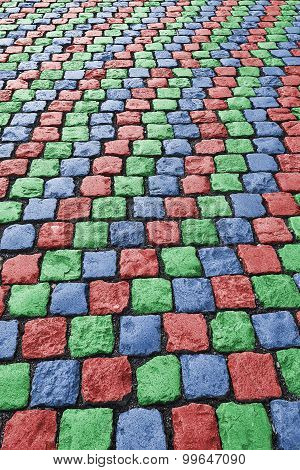 Red Green Blue Colored Cobbled Road