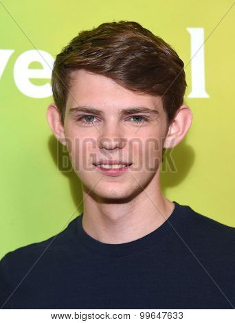 LOS ANGELES - AUG 13:  Robbie Kay arrives to the Summer 2015 TCA's - NBCUniversal  on August 13, 2015 in Hollywood, CA