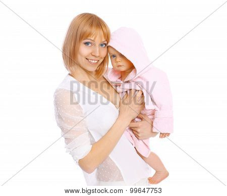 Portrait Of Mother Holding Baby In The Bathrobe On A White Background