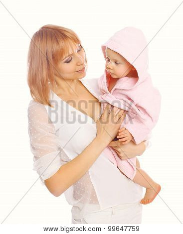 Portrait Of Young Mother Holding Baby In The Bathrobe