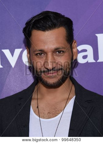 LOS ANGELES - AUG 12:  Cas Anvar arrives to the arrives to the Summer 2015 TCA's - NBCUniversal  on August 12, 2015 in Beverly Hills, CA