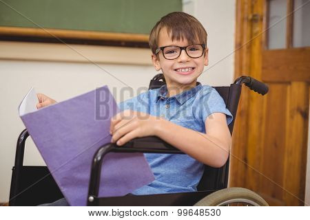 Disabled pupil smiling at camera at the elementary school