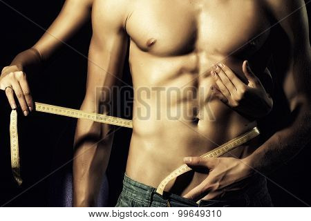 Couple With Tape Measure