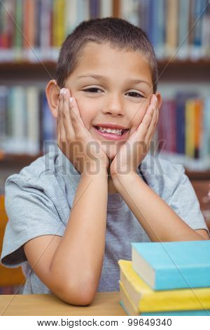 Pupil smiling at camera in library at the elementary school