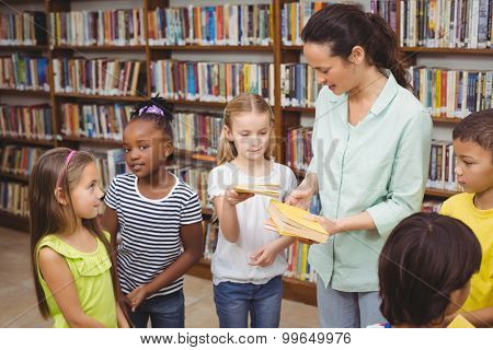 Pupils and teacher in the library at the elementary school