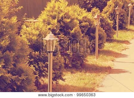 lamp on green grass background retro