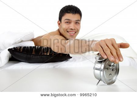 Young Nepalese Man Stopping Alarm Clock