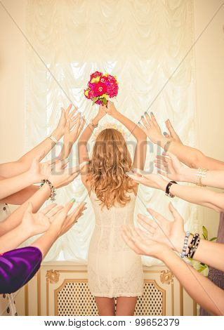 The Bride Throws Her Bouquet.