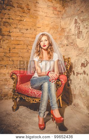 Bride Sitting On A Chair Girl With Bright Red Lips