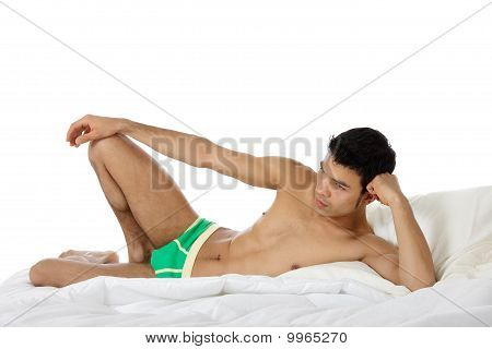Young Attractive Nepalese Man On The Bed