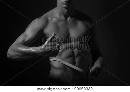 Man And Tape Measure