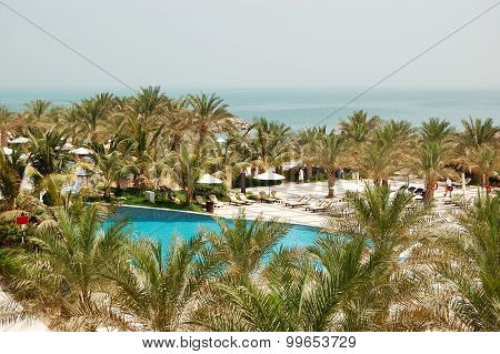 Swimming Pool And Beach At Luxury Hotel, Ras Al Khaimah, Uae