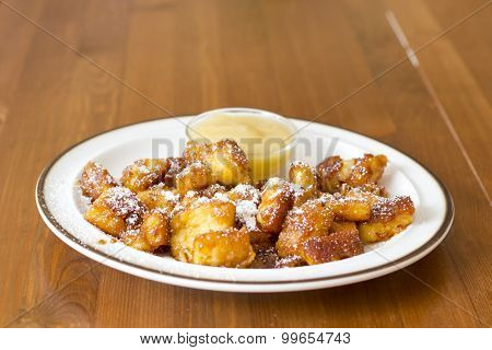 Kaiserschmarrn (traditional Austrian pancake) with sugar powder and applesauce
