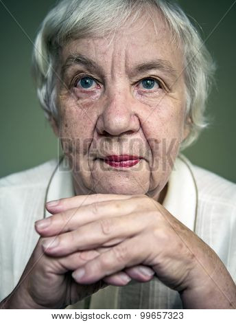 Portrait of a gray-haired elderly woman