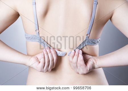 Closeup Of A Woman Undressing And Unhooking Her Bra. Woman Taking Off Her Bra