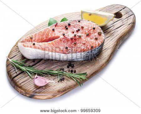 Salmon steak on cutting board white background.