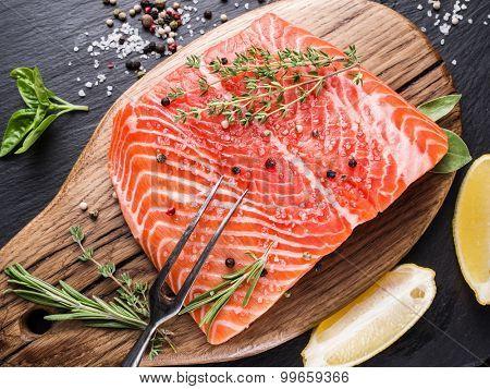 Fresh salmon on the cutting board. Cooking process.